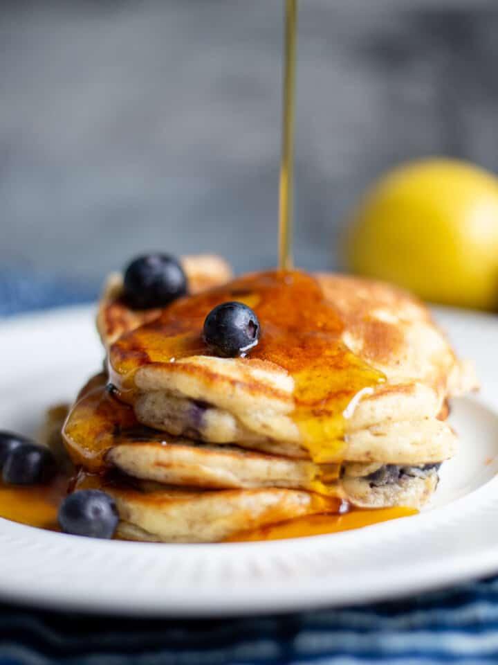 Lemon blueberry pancakes on white plate
