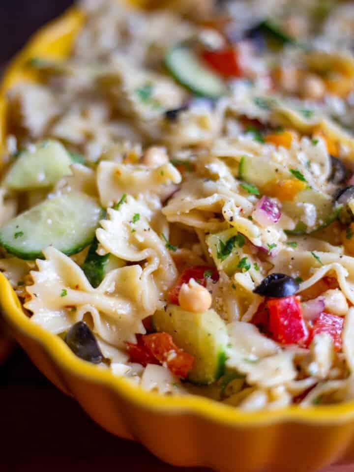 Mediterranean Pasta Salad in yellow bowl