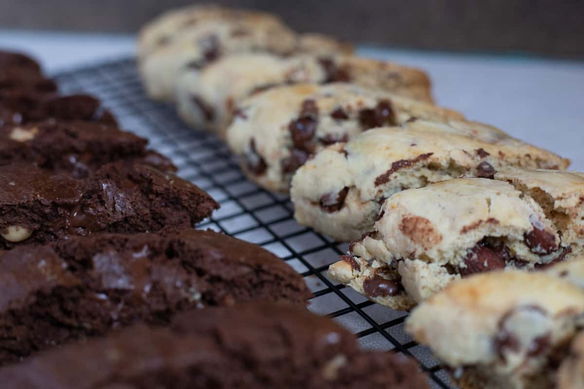 Allmond chocolate chip biscotti on wire cooling rack.
