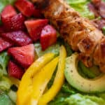 Chicken kabob on bed of salad