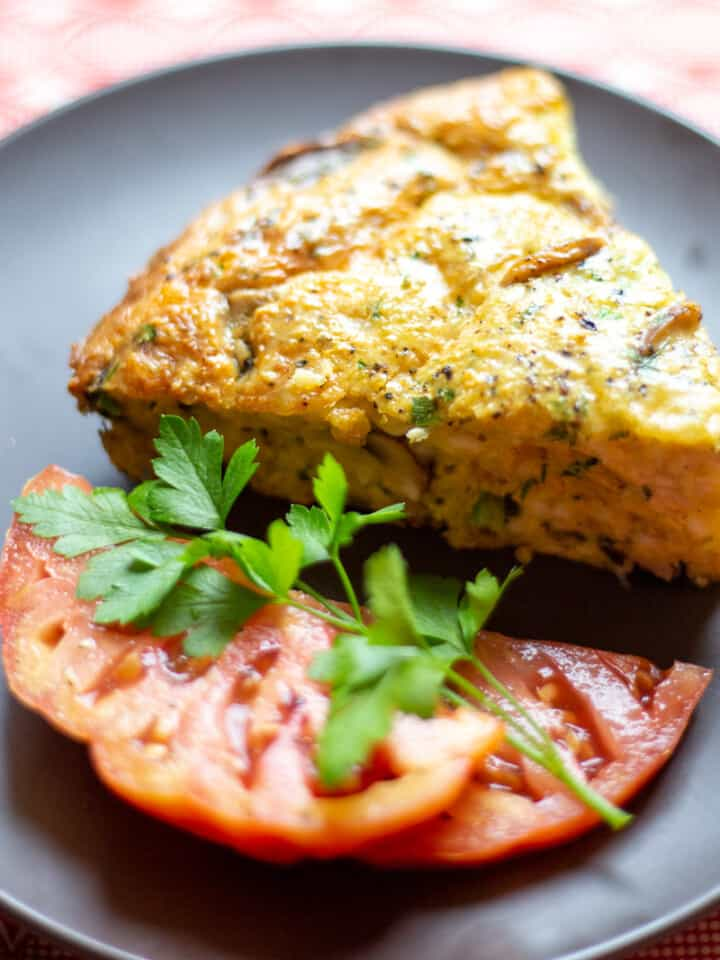 mushroom frittata with tomato on brown plate