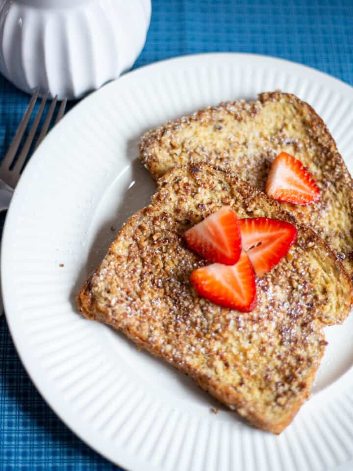 French Toast on white plate with strawberries