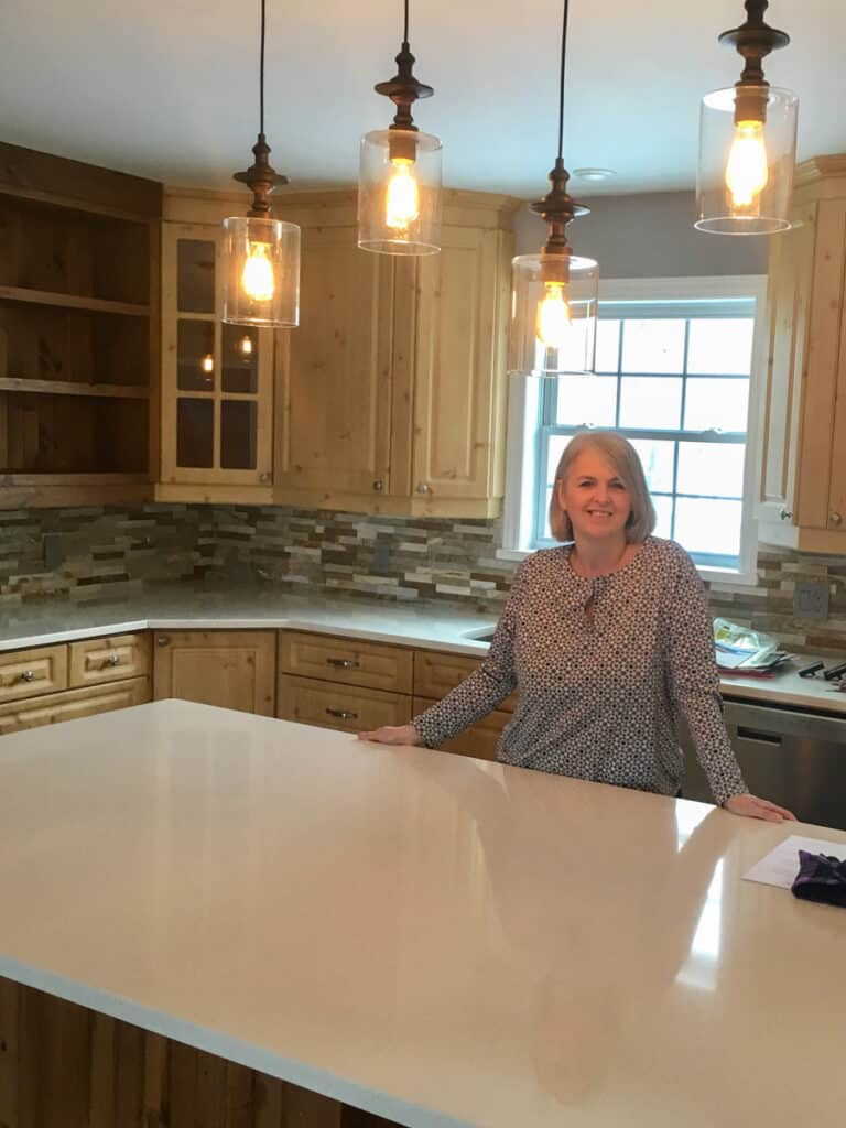 photo of me standing in my new kitchen
