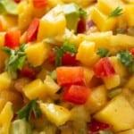 Close up image on peach mango salsa in blue bowl.