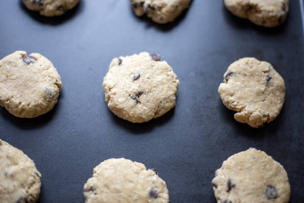 unbaked oatmeal chocolate chip cookies on baking sheet