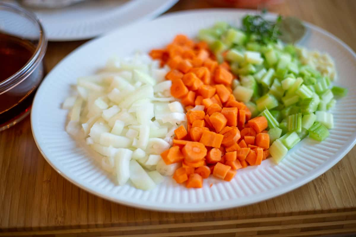 Vegetables and garlic chopped on a plate ready for the recipe.