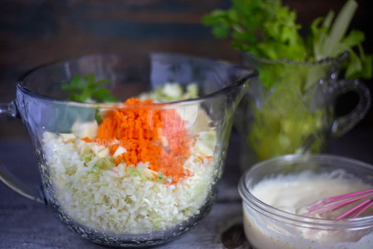 Creamy coleslaw vegetables with creamy dressing in glass bowls.