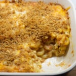 Baked Mac and cheese with tomatoes in blue baking dish.