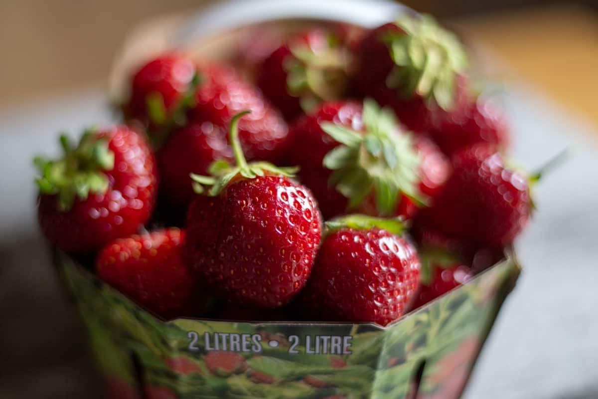 Two litre container of fresh strawberries.