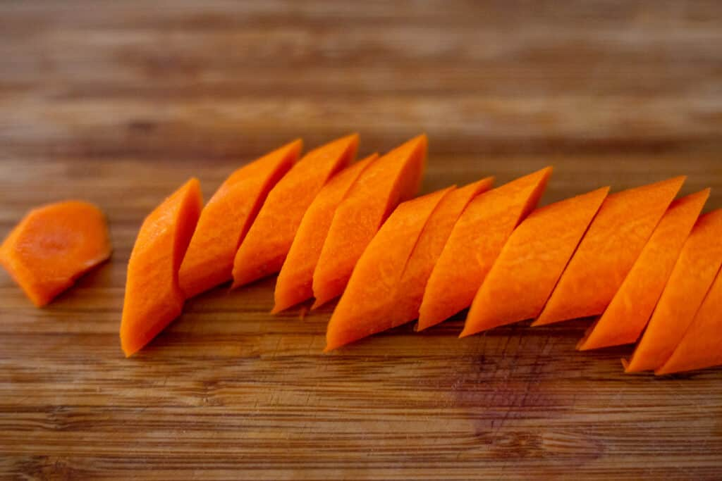 photo of carrots sliced on the diagonal