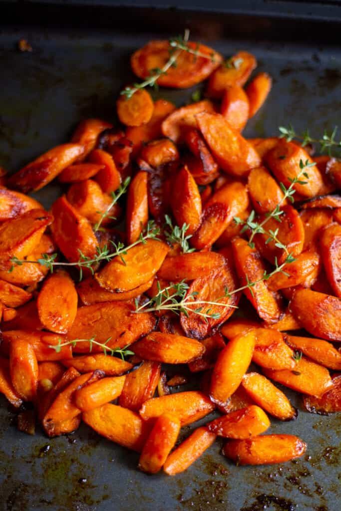 roasted carrots with thyme on baking sheet