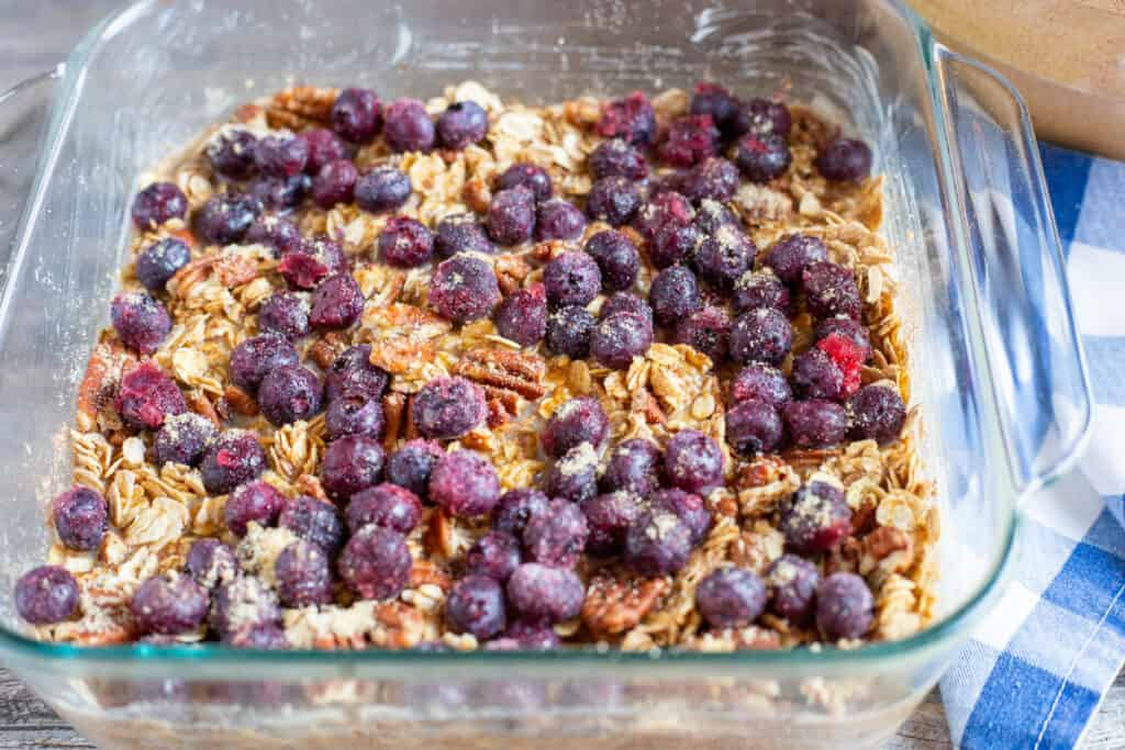 blueberry baked oatmeal prepared in glass baking dish ready to go into the oven