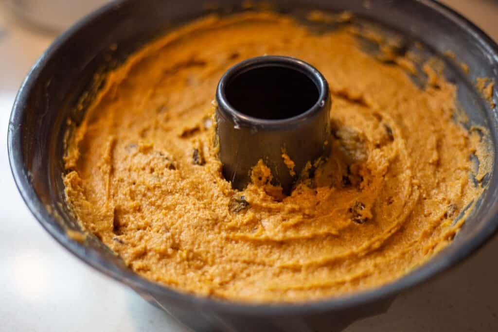 pumpkin spice bundt cake batter in bundt cake pan ready to go into the oven