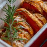 roasted sweet potatoes in red casserole dish