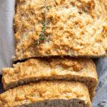 Loaf of beer bread with two slices leaning on the front with text overlay.