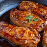 Cooked Honey Garlic pork chops in a cast iron skillet.