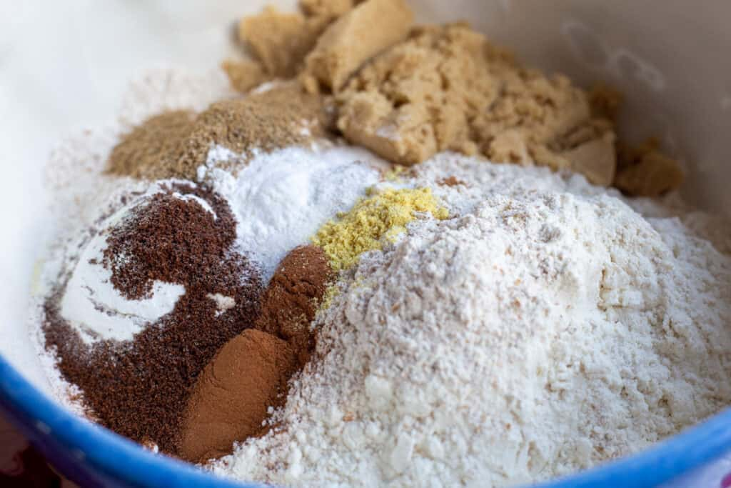 All ingredients for Gingerbread Squares Mix in a large mixing bowl ready to be mixed.