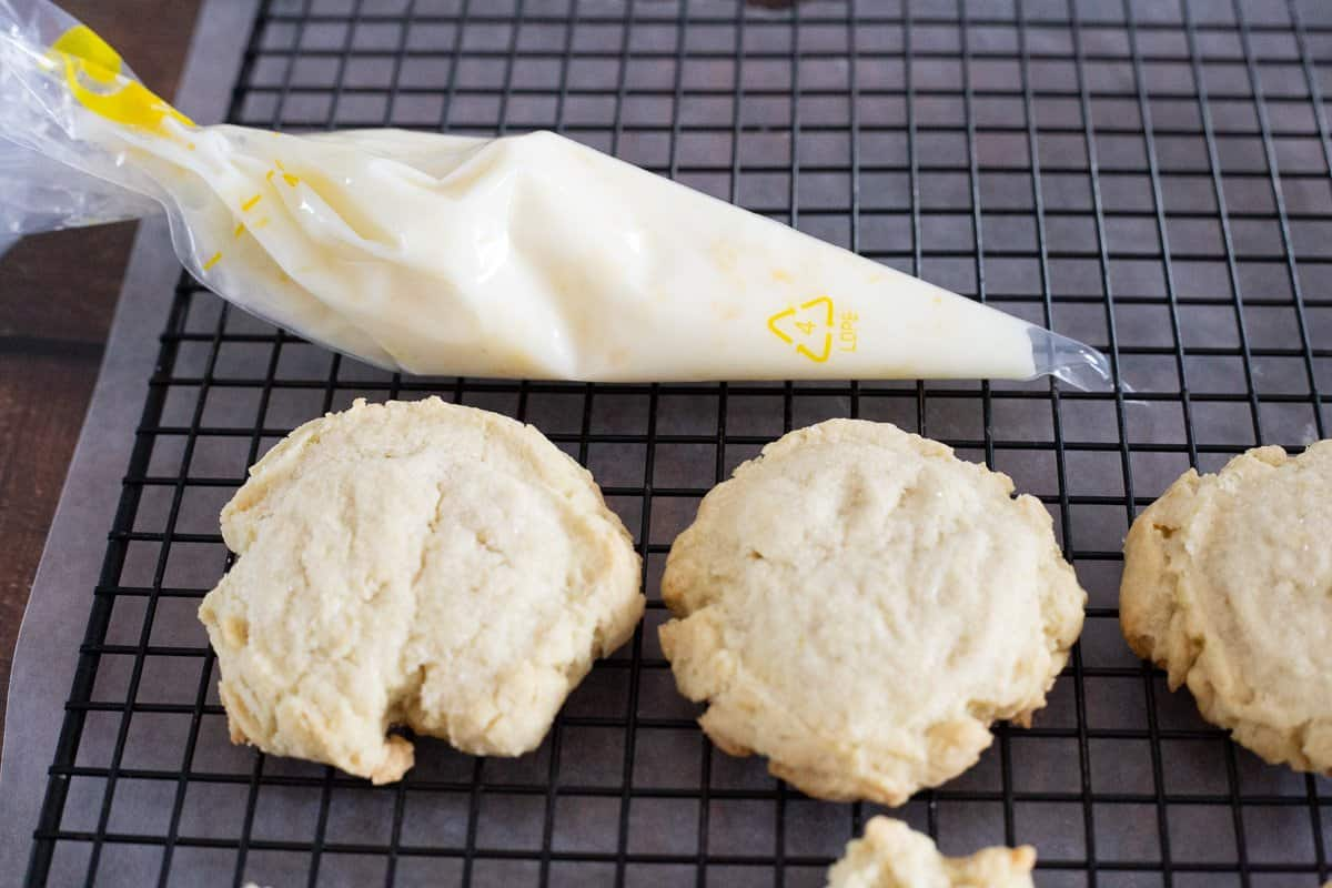 Process photo showing the icing in decorating bag ready to be piped onto the cookies.