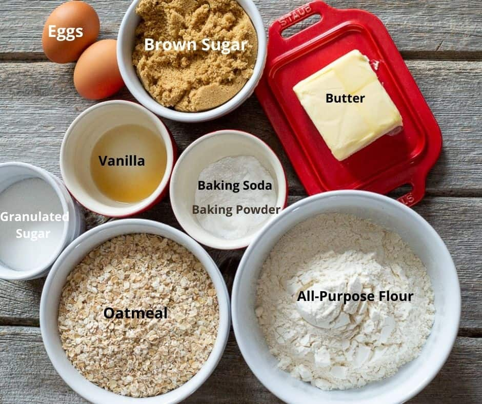 All of the ingredients required to make oatmeal cookies recipe with text overlay on each ingredient.