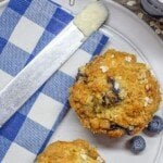 Banana Blueberry Oatmeal Muffin sit-in gon a plate with text overlay.