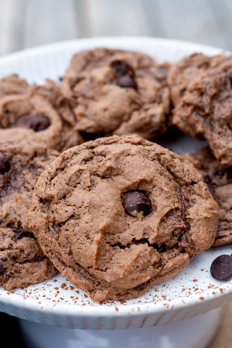 Close up image of Double Chocolate Chip Cookies on a white plate.