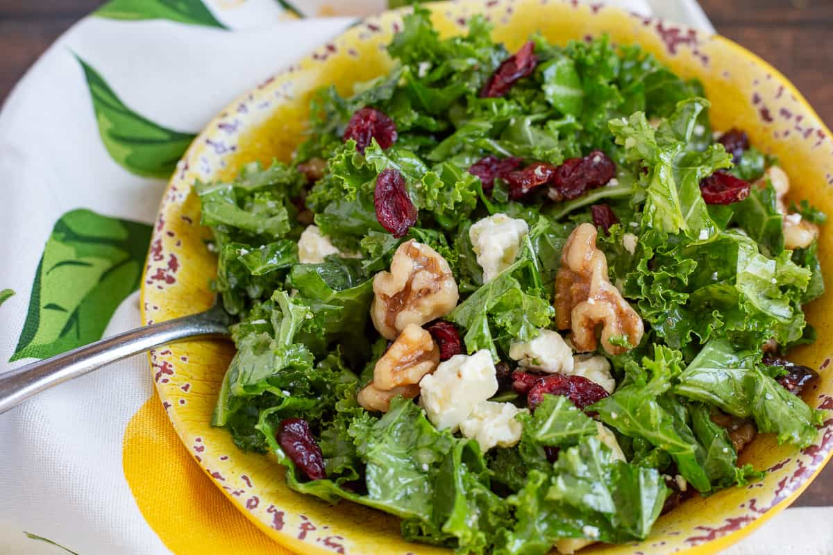 Close up image of Kale Salad in yellow bowl.