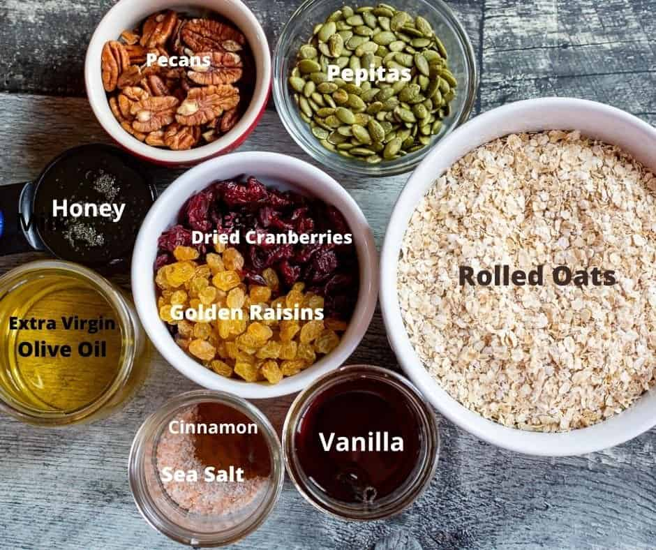 Ingredients for homemade granola in small bowls with text overlay.