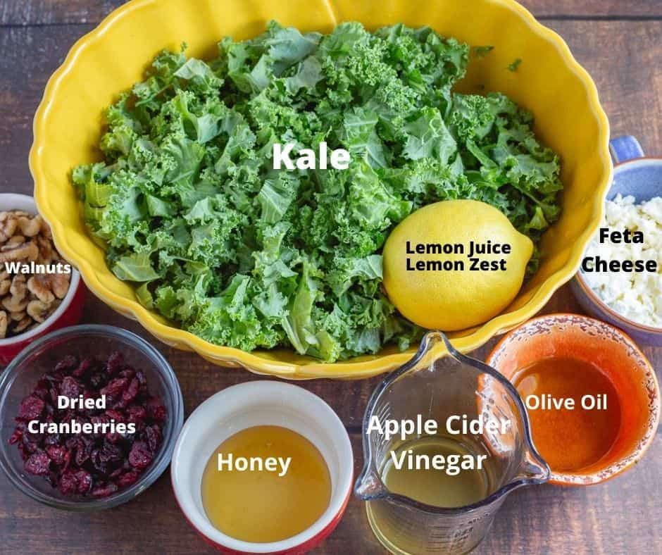 Ingredients for kale salad with text overlay.