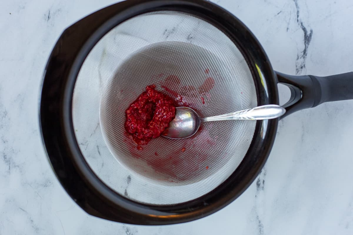 Raspberry purée if pressed through a sieve with a spoon.