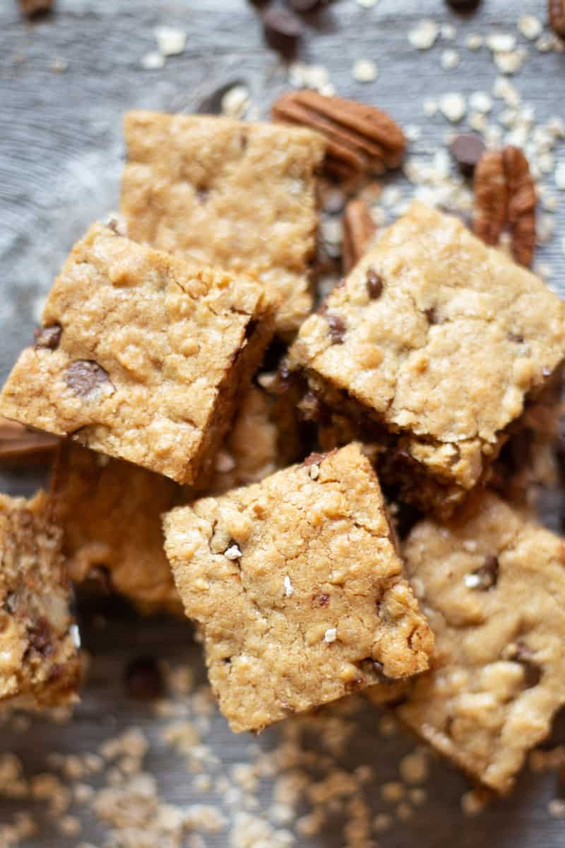 Close up image of stacked Oatmeal Chocolate Chip & Peanut Butter Bars.