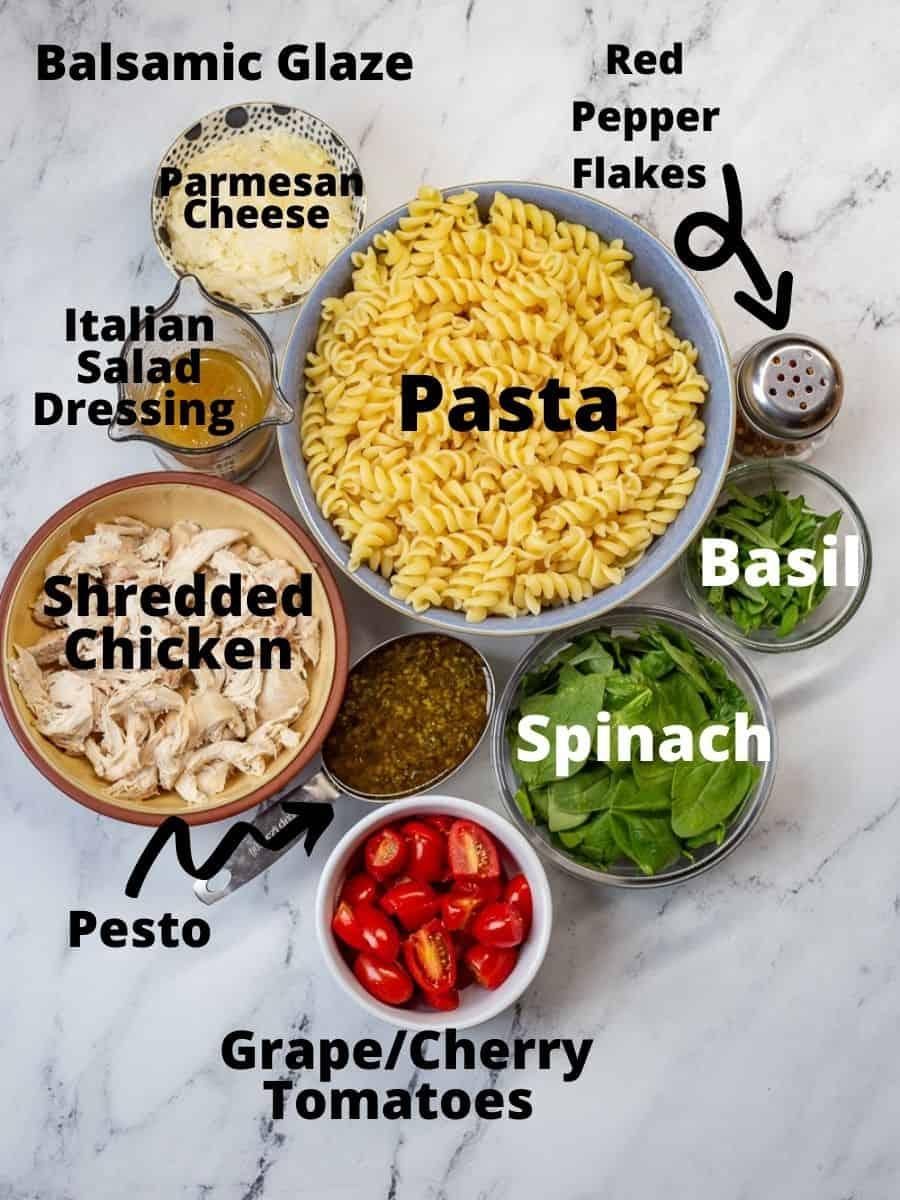 Ingredients for pesto chicken pasta salad.