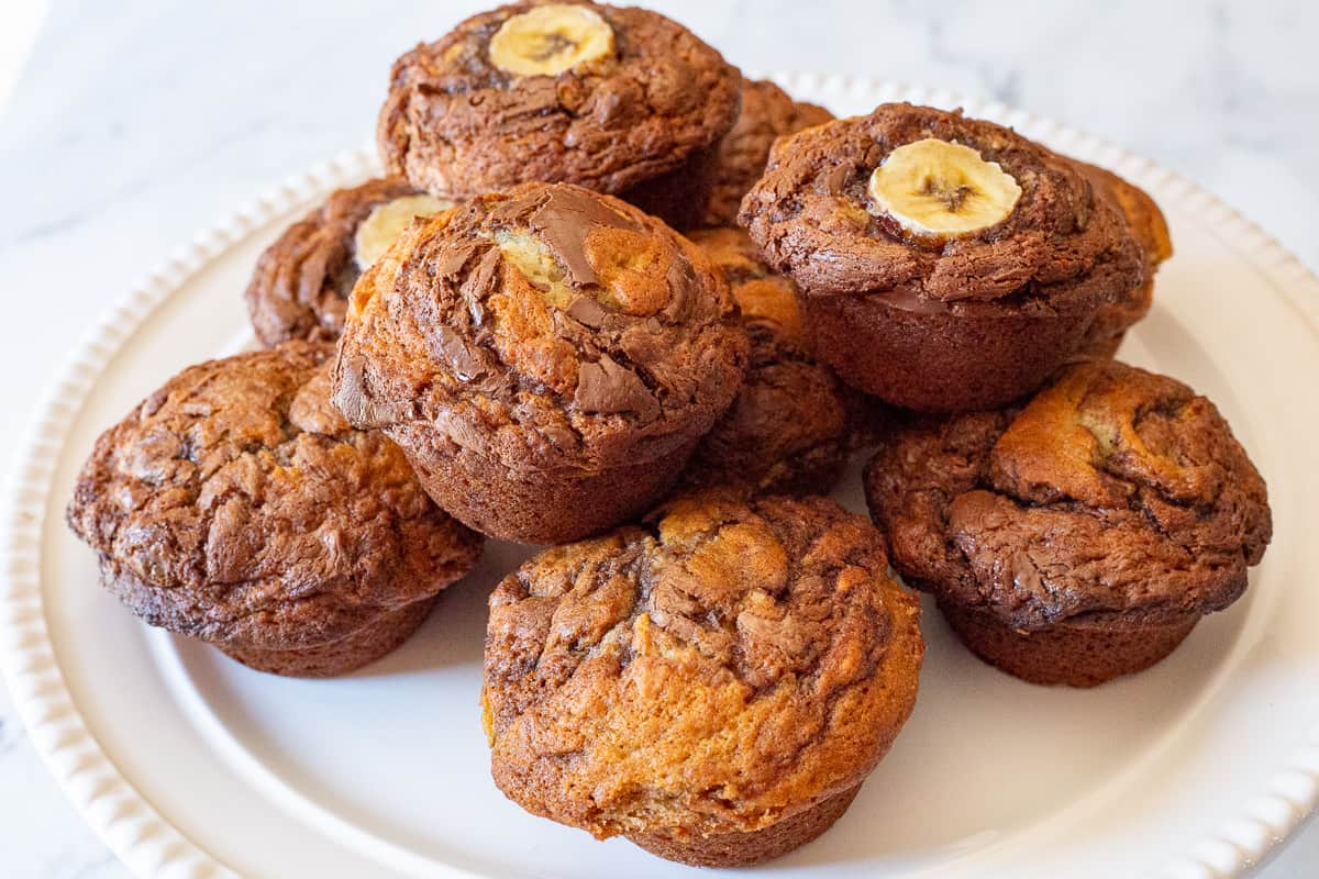 Baked Banana Nutella Muffins on a white plate.