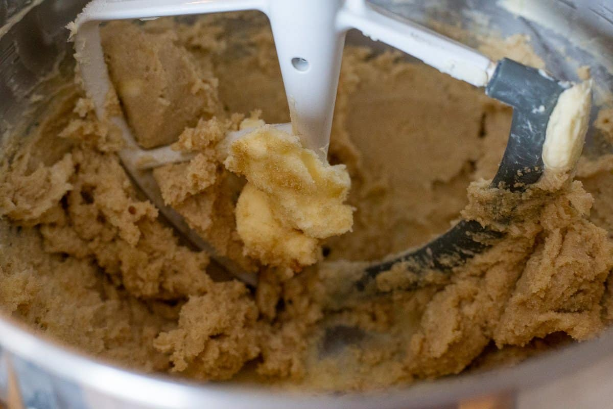 Butter and both sugars in mixing bowl of stand mixer.