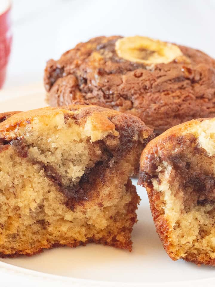 Close up image of Banana Nutella Muffins on a white plate.