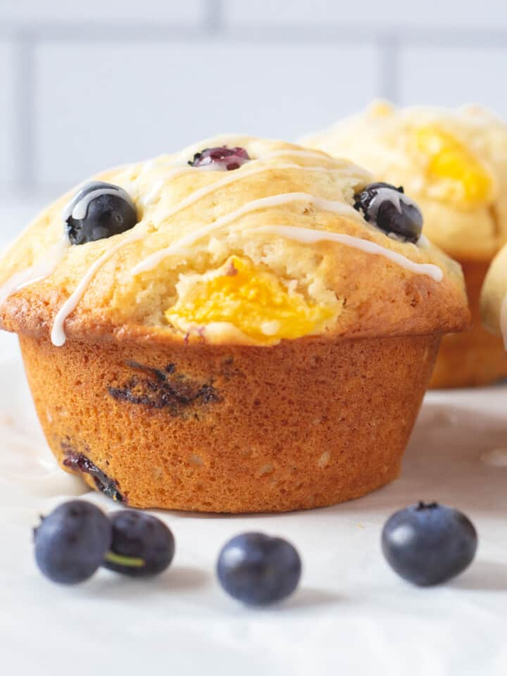 Close up image of the side view of blueberry peach muffins.