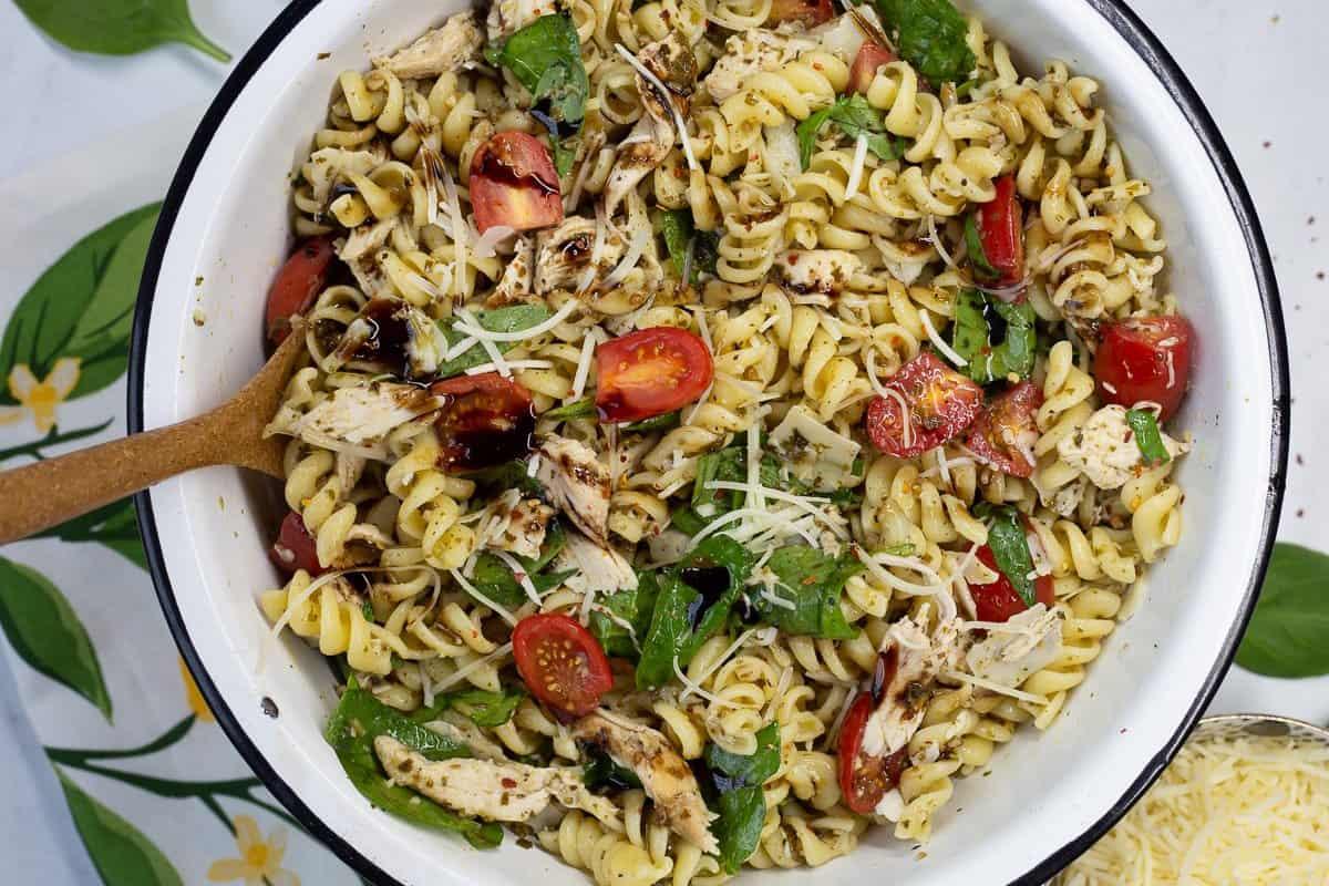Close up image of Pesto Chicken Pasta Salad with spoon.