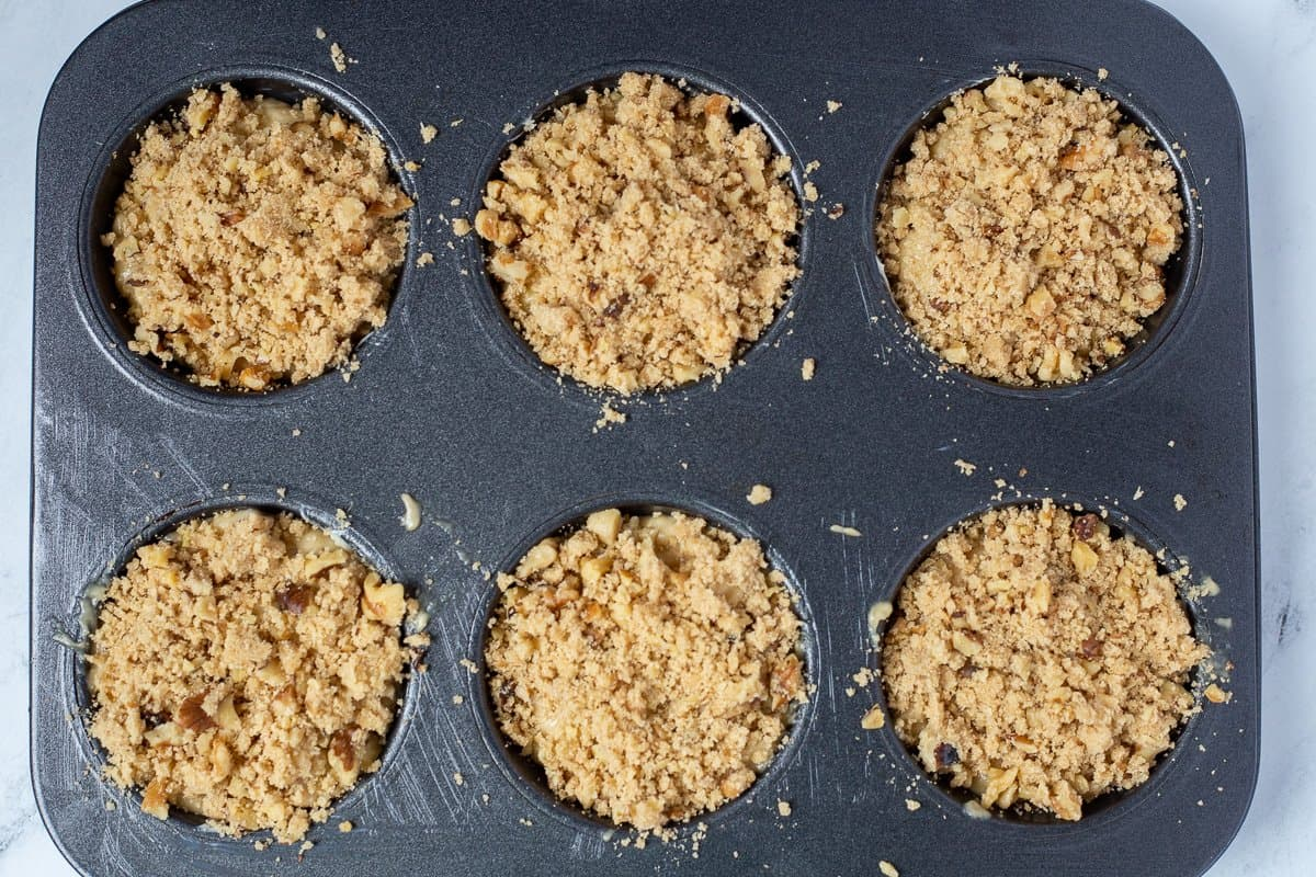 Streusel topping on muffins ready to go into the oven.