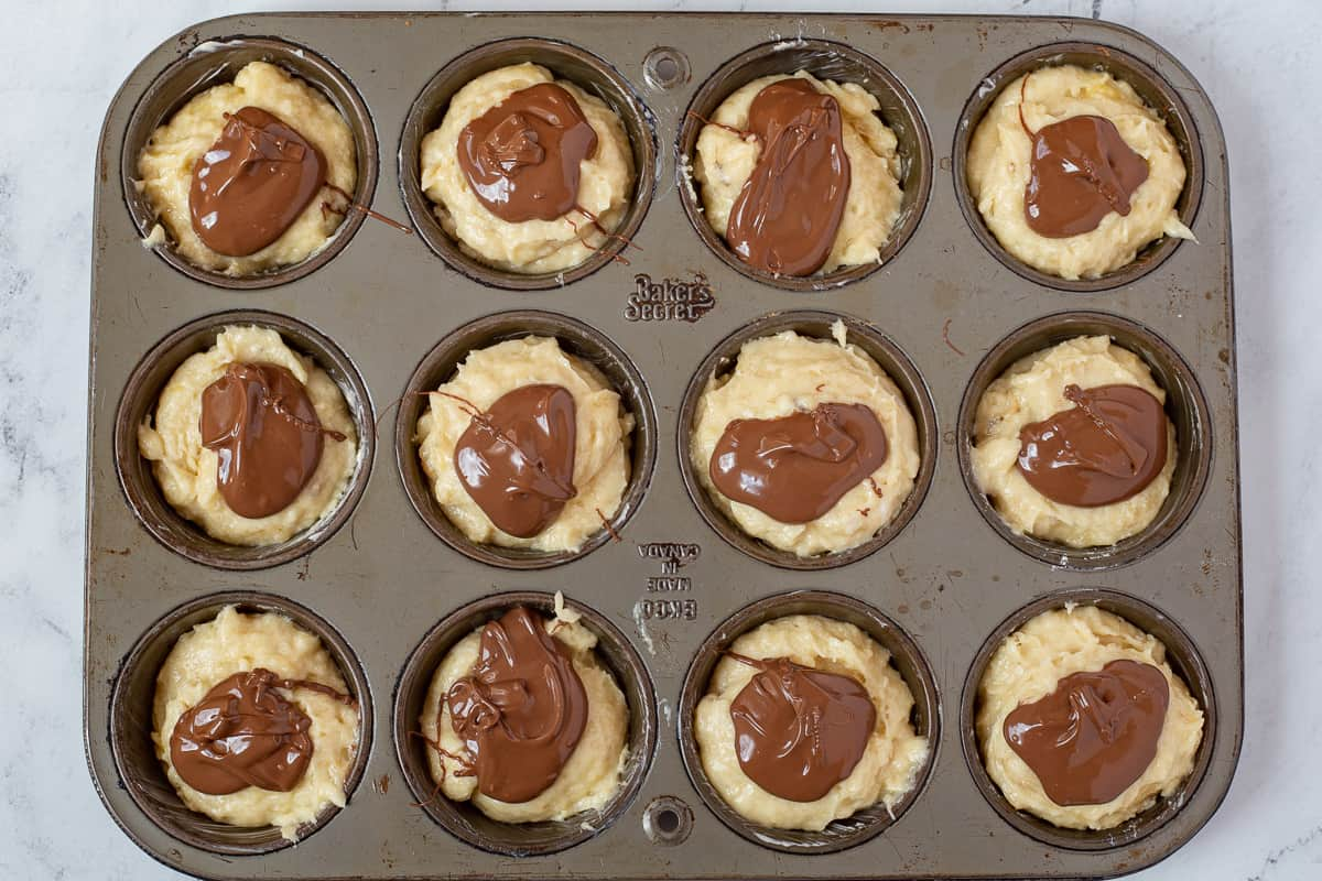 Muffin batter in tins.