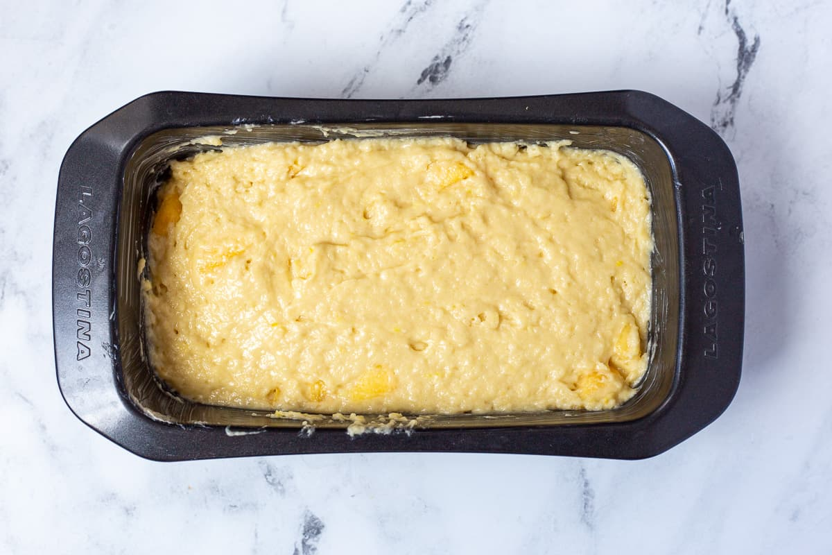 Peach bread batter in loaf pan ready for the oven.