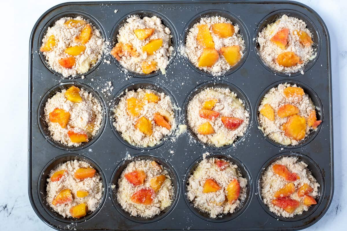 Muffin batter in greased muffin tins.