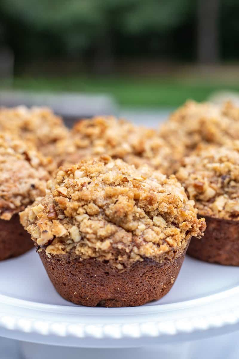 Close up image of Bakery Style Banana Nut Muffins on white plate.