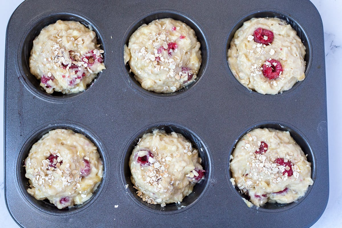 Batter is divided evenly in six greased jumbo muffin tins.