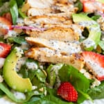 Spinach and Strawberry Salad on a white plate.