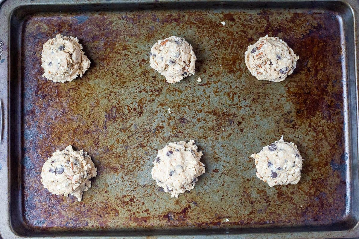 Unbaked cookies on cookie sheet ready to go into the oven.