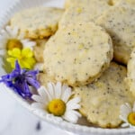 Lemon Poppy Seed Cookies on a white plate with flowers.