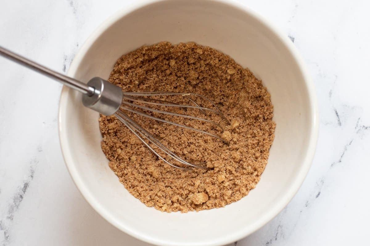Brown sugar and cinnamon in small mixing bowl with wire whisk.