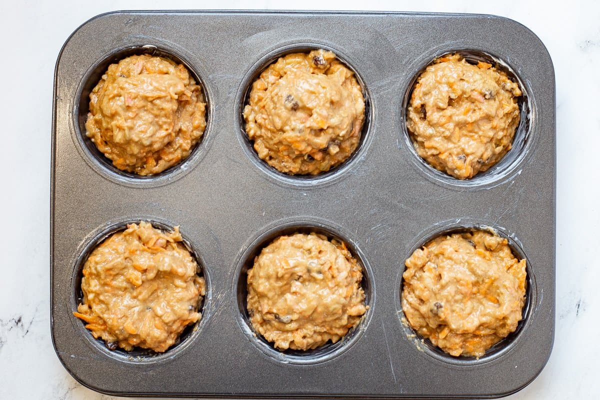 Unbaked muffin in jumbo muffin tins ready for the oven.