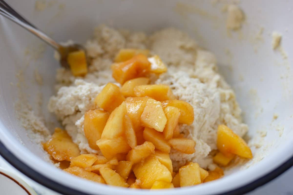 Peaches are added to the batter.