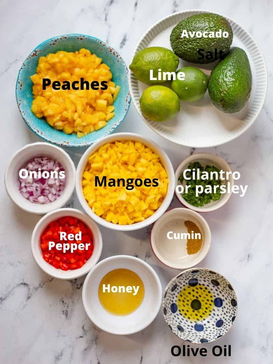 Ingredients for the best peach mango salsa with text overlay.