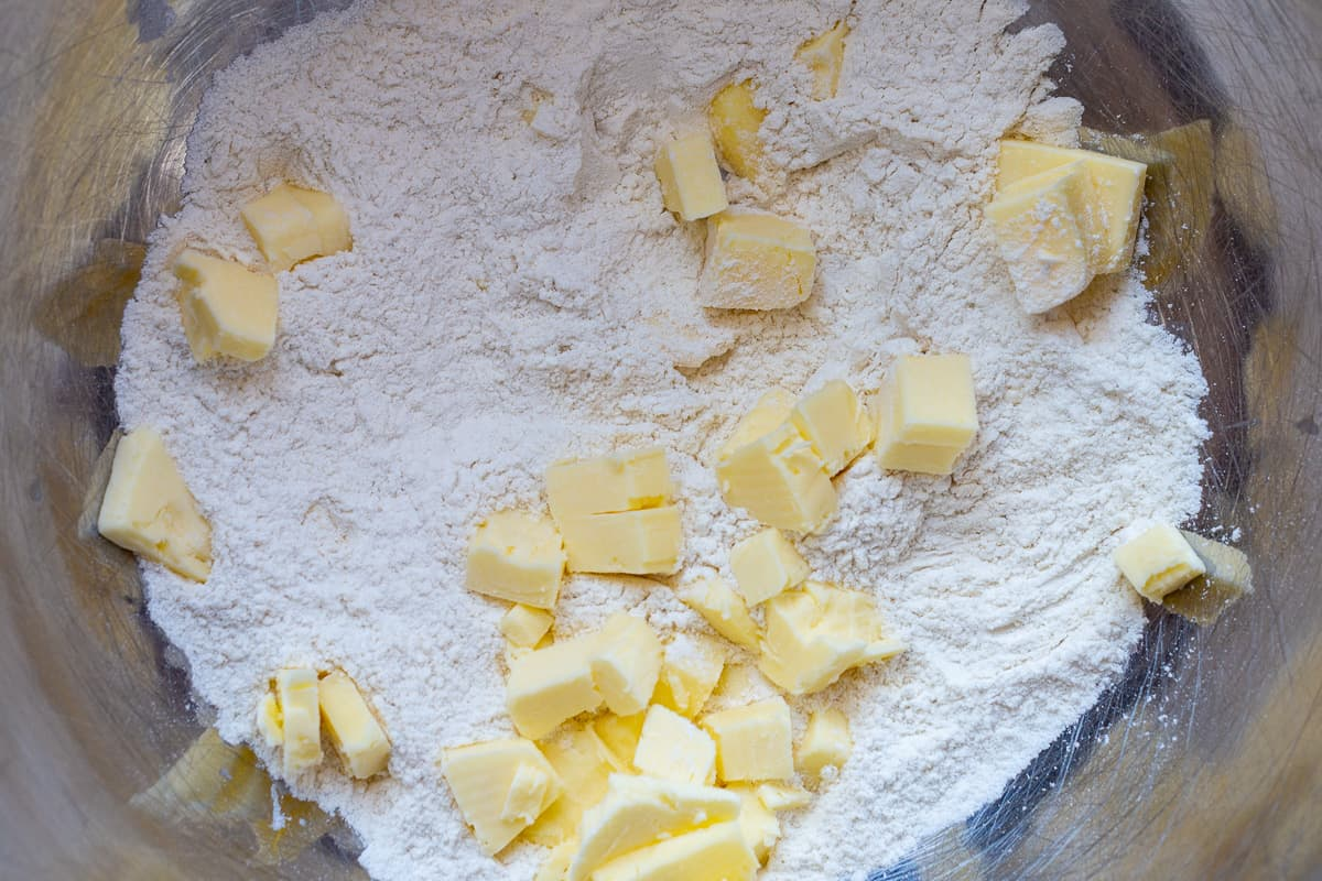 Butter is added to flour mixture.
